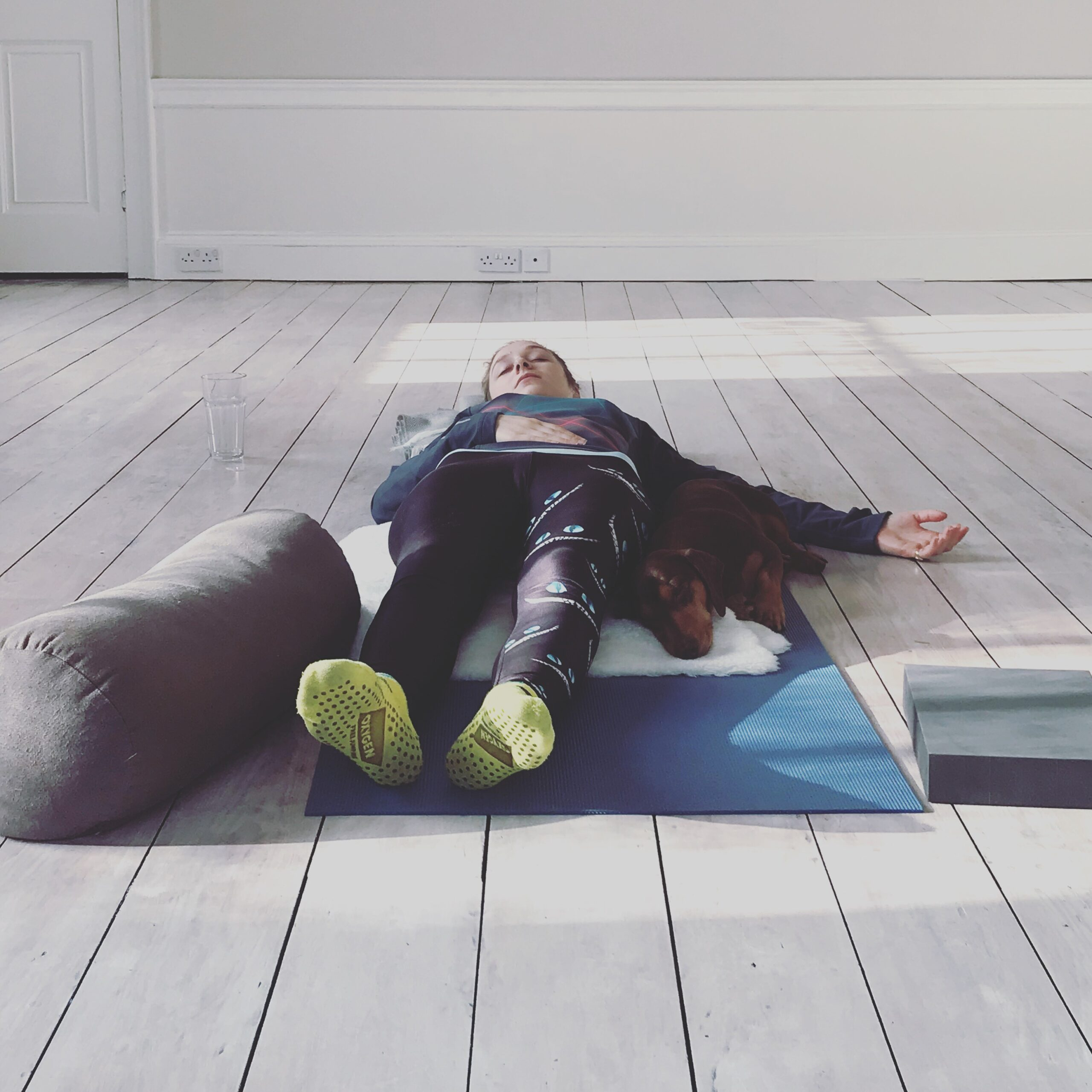 yogaspaceyorkshire studio with one student in savasana